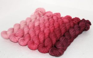 Handdyed socks in pink gradient by dublin dye company